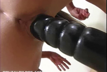 Alissa riding a thick brutal dildo